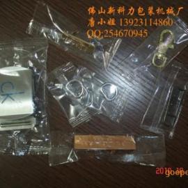 精品推荐:惠州手袋五金包装机-广州五金产品自动套袋机