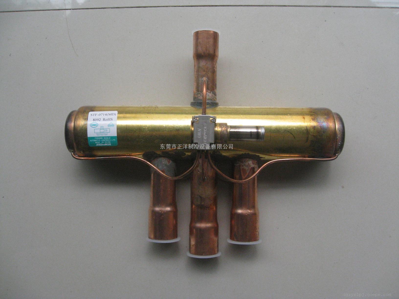 四通阀是制冷设备中不可缺少的部件,其工作原理是图片