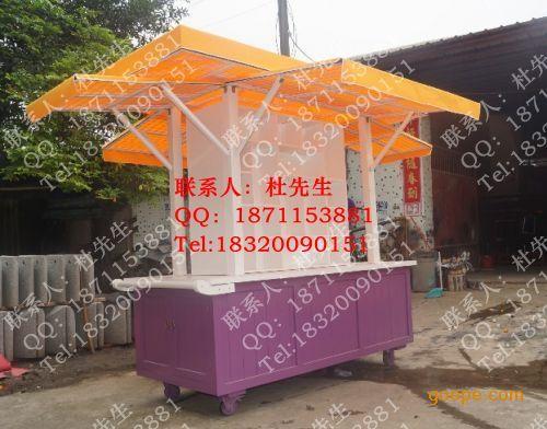 街 木制移动售货车,济南饰品售货车,流高清图片